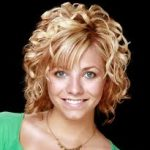 Curly Highlighted Short Hairstyle with Heavy Side Swept Bangs and Layers