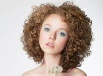 Naturally Curly Short Hairstyle with Side Part and Bangs