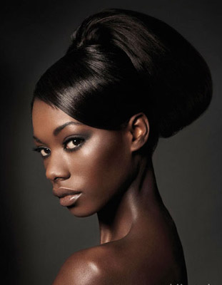 Half up and half open with fancy hair accessory African Bridal Hairstyles