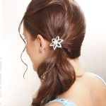 Ponytail hairstyle with soft romantic touch