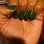 Green color of nail polish on dark skin