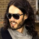 long hairstyle and beard wearing sunglasses