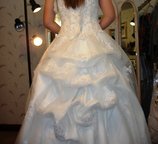 How to do a french bustle on a wedding dress train sew for Wedding dress train bustle