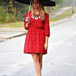 dress in rain under Umbrella