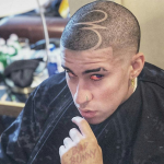 shaved hairstyle bad bunny